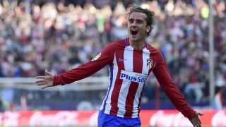 Atletico Madrid's French forward Antoine Griezmann celebrates after scoring during the Spanish league football match Club Atletico de Madrid vs Sevilla FC at the Vicente Calderon stadium in Madrid on March 19, 2017. / AFP PHOTO / PIERRE-PHILIPPE MARCOU
