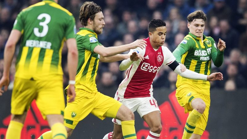 Ajax Amsterdam's Justin Kluivert (C) vies for the ball with ADO The Hague's Dion Malone (L) and Danny Bakker (R) during the Dutch Eredivisie football match between Ajax and ADO The Hague on January 29, 2017 in Amsterdam. / AFP PHOTO / ANP / Olaf KRAAK / Netherlands OUT