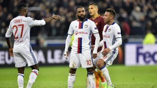 Lyon's French forward Alexandre Lacazette (C) celebrates with teammates after scoring during the UEFA Europa League round of 16 football match between Lyon and AS Roma at the Parc Olympique Lyonnais stadium in Decines-Charpieu near Lyon, central-eastern France, on March 9, 2017. / AFP PHOTO / ROMAIN LAFABREGUE