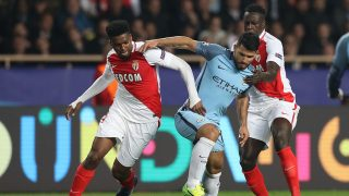Manchester City's Argentinian striker Sergio Aguero (C) challenges Monaco's Brazilian defender Jemerson and Monaco's French defender Benjamin Mendy (R) during the UEFA Champions League round of 16 football match between Monaco and Manchester City at the Stade Louis II in Monaco on March 15, 2017. / AFP PHOTO / Valery HACHE