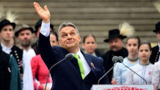 Hungarian Prime Minister Viktor Orban waves to the crowd after his speech in front of the National Museum of Budapest on March 15, 2017 during official festivities to celebrate the anniversary of the Hungarian Revolution.The 1848/1849 revolution in the Kingdom of Hungary grew into a war for independence from the Austrian Empire, ruled by the Habsburg dynasty. / AFP PHOTO / ATTILA KISBENEDEK