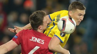 ROSTOV-ON-DON, RUSSIA - MARCH 09: Phil Jones of Manchester United (L) in action against Aleksandr Bukharov (R) of FC Rostov during the UEFA Europa League Round of 16 first leg match between FC Rostov and Manchester United at Olimp-2 on March 9, 2017 in Rostov-on-Don, Russia. Andrey Bogunov / Anadolu Agency