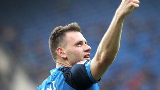 Hoffenheim's Hungarian forward Adam Szalai celebrates scoring the 4-2 during the German First division Bundesliga football match between TSG Hoffenheim and FC Ingolstadt 04 in Sinsheim, Germany, on March 4, 2017. / AFP PHOTO / Daniel ROLAND / RESTRICTIONS: DURING MATCH TIME: DFL RULES TO LIMIT THE ONLINE USAGE TO 15 PICTURES PER MATCH AND FORBID IMAGE SEQUENCES TO SIMULATE VIDEO. == RESTRICTED TO EDITORIAL USE == FOR FURTHER QUERIES PLEASE CONTACT DFL DIRECTLY AT + 49 69 650050