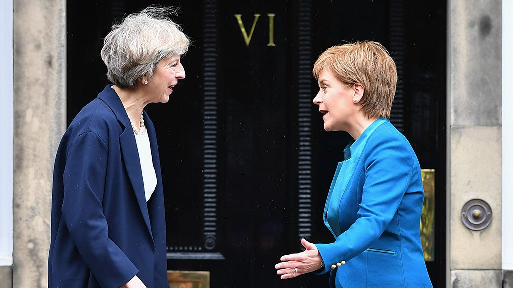 EDINBURGH, SCOTLAND - JULY 15: Prime Minister Theresa May meets with First Minister Nicola Sturgeon on the steps of Bute House on July 15, 2016 in Edinburgh, Scotland. Prime Minister flew in for Brexit talks with the First Minister, and is expected to express that she wants the Scottish Government to play a key role in negotiations with the EU.  (Photo by Jeff J Mitchell/Getty Images)