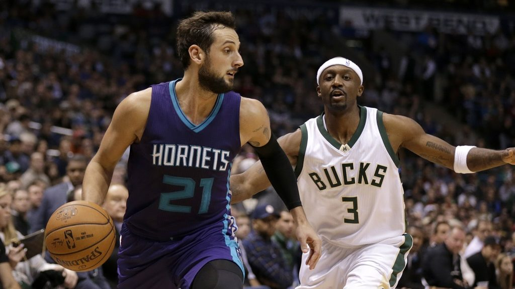 MILWAUKEE, WI - OCTOBER 26: Marco Belinelli #21 of the Charlotte Hornets dribbles the basketball as Jason Terry #3 of the Milwaukee Bucks defends during the fourth quarter at BMO Harris Bradley Center on October 26, 2016 in Milwaukee, Wisconsin. NOTE TO USER: User expressly acknowledges and agrees that, by downloading and or using this photograph, User is consenting to the terms and conditions of the Getty Images License Agreement.   Mike McGinnis/Getty Images/AFP