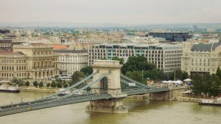 Szechenyi Chain Bridge Is A Suspension Bridge That Spans The River Danube Between Buda And Pest, The Western And Eastern Sides Of Budapest, The Capital Of Hungary
