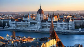 The Hungarian Parliament Building (Hungarian: Országház), also known as the Parliament of Budapest for being located in that city, is the seat of the National Assembly of Hungary, one of Europe's oldest legislative buildings, a notable landmark of Hungary and a popular tourist destination of Budapest.