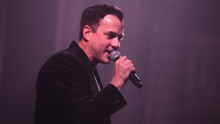 NEW YORK, NY - DECEMBER 06: VP, Head of Industry Relations Tommy Page speaks on stage at the PANDORA Holiday Discovery Den at The Grand Ballroom at Manhattan Center on December 6, 2014 in New York City.   Stephen Lovekin/Getty Images for Pandora Media/AFP