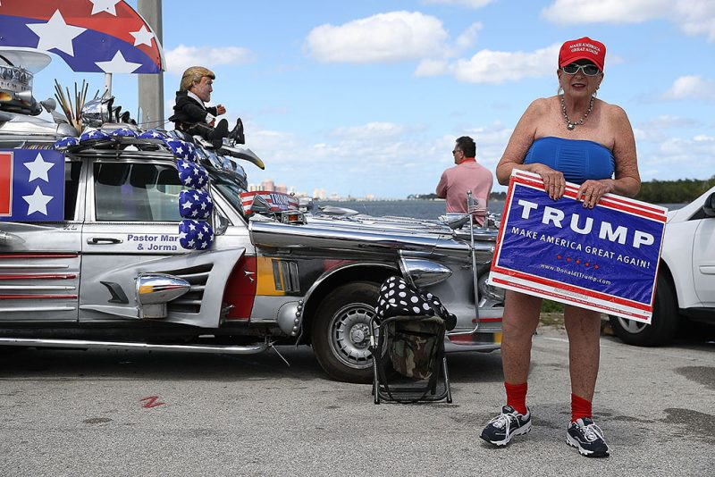 WEST PALM BEACH, FL - MARCH 04:  Madi Page shows her support for President Donald Trump near his Mar-a-Lago resort home on March 4, 2017 in West Palm Beach, Florida. President Trump spent part of the weekend at the house.  (Photo by Joe Raedle/Getty Images)