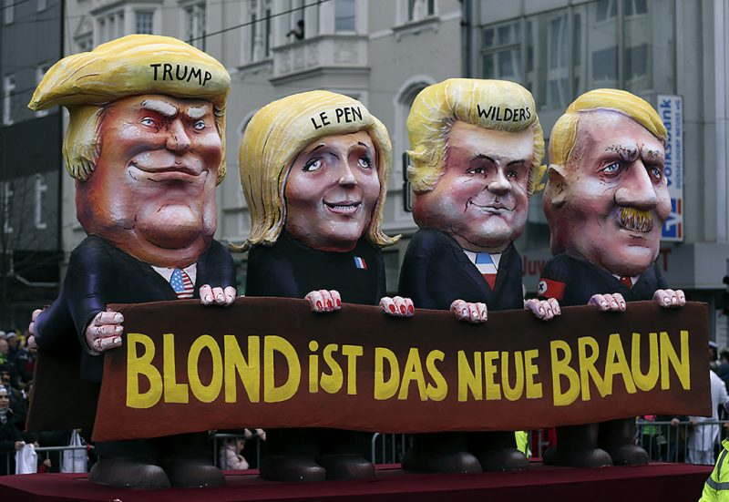 DUESSELDORF, GERMANY - FEBRUARY 27: A carnival float with a papier-mache caricatures of Donald Trump, Marine Le Pen, Geert Wilders and Adolf Hitler is seen during the traditional Rose Monday carnival parade in Duesseldorf, Germany on February 27, 2017. The annual Rose Monday carnival parade in Duesseldorf is one of most popular carnival parades in Germany. (Photo by Leon Kuegeler/Anadolu Agency/Getty Images)
