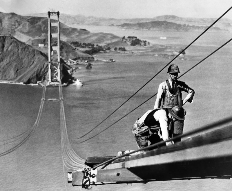 Picture dated October 1935 of the Golden Gate bridge, in the San Francisco Bay, during its construction. Construction began on 05 January 1933 and the bridge was inaugurated 27 May 1937 by Franklin Delano Roosevelt, who pushed a button in Washington, DC, signaling the official start of vehicle traffic over the Bridge. Idea of the engineer Joseph Strauss, it was the largest suspension bridge in the world. / AFP PHOTO / ACME / -