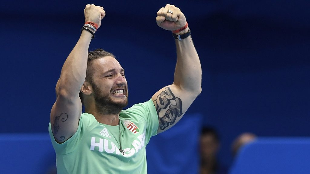 Shane Tusup, the husband and coach of Hungary's Katinka Hosszu celebrates after his wife broke the world record to win the Women's 400m Individual Medley Final during the swimming event at the Rio 2016 Olympic Games at the Olympic Aquatics Stadium in Rio de Janeiro on August 6, 2016. / AFP PHOTO / CHRISTOPHE SIMON