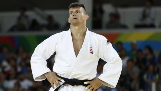 Hungary's Miklos Ungvari (white) competes with US Nicholas Delpopolo during their men's -73kg judo contest repechage match of the Rio 2016 Olympic Games in Rio de Janeiro on August 8, 2016. / AFP PHOTO / Jack GUEZ