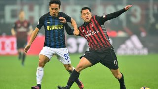 Inter Milan's defender from Japan Yuto Nagatomo (L) fights for the ball with AC Milan's forward from Italy Gianluca Lapadula during the Italian Serie A football match AC Milan Vs Inter Milan on November 20, 2016 at the 'San Siro Stadium' in Milan.  / AFP PHOTO / GIUSEPPE CACACE