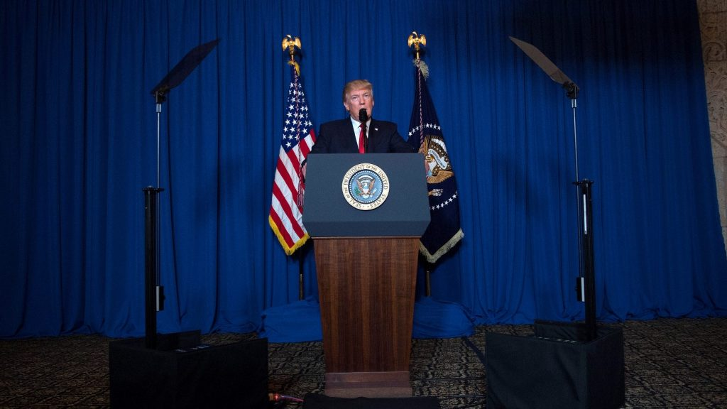 US President Donald Trump delivers a statement on Syria from the Mar-a-Lago estate in West Palm Beach, Florida, on April 6, 2017. Trump ordered a massive military strike against a Syria Thursday in retaliation for a chemical weapons attack they blame on President Bashar al-Assad. A US official said 59 precision guided missiles hit Shayrat Airfield in Syria, where Washington believes Tuesday's deadly attack was launched.  / AFP PHOTO / JIM WATSON