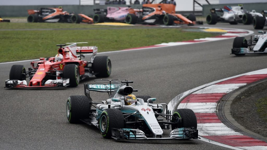 Mercedes' British driver Lewis Hamilton takes a corner during the Formula One Chinese Grand Prix in Shanghai on April 9, 2017. / AFP PHOTO / WANG ZHAO