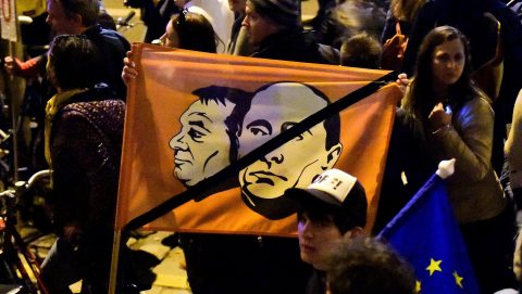 Local demonstrators march with a flag with the image of Russian President Vladimir Putin and Hungarian Prime Minister Viktor Orban close to the headquarter of the governor FIDESZ party at Heroes Square as students, teachers of the Central European University and their sympathizers protest in downtown Budapest on April 9, 2017.  Hungarian lawmakers approved legislation that could force the closure of a prestigious Budapest university founded by US billionaire investor George Soros, sparking fresh protests. The English-language Central European University (CEU), set up in 1991 after the fall of communism, has long been seen as a hostile bastion of liberalism by Prime Minister Viktor Orban's government.  / AFP PHOTO / ATTILA KISBENEDEK