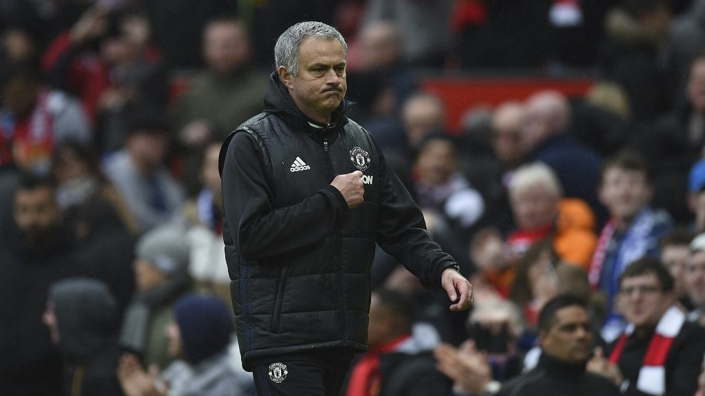 Manchester United's Portuguese manager Jose Mourinho points at the badge on his chest as he leaves the pitch at the end of the English Premier League football match between Manchester United and Chelsea at Old Trafford in Manchester, north west England, on April 16, 2017. / AFP PHOTO / Oli SCARFF / RESTRICTED TO EDITORIAL USE. No use with unauthorized audio, video, data, fixture lists, club/league logos or 'live' services. Online in-match use limited to 75 images, no video emulation. No use in betting, games or single club/league/player publications.  /