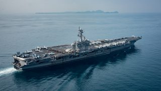 """The aircraft carrier USS Carl Vinson (CVN 70) transits the Sunda Strait between the Indonesian Islands of Java and Sumatra on April 15, 2017 after the US Navy announced it  had sent a carrier-led strike group to the Korean peninsula in a show of force against North Korea's """"reckless"""" nuclear weapons program.  """"US Pacific Command ordered the Carl Vinson Strike Group north as a prudent measure to maintain readiness and presence in the Western Pacific,"""" said Commander Dave Benham, spokesman at US Pacific Command. The Carl Vinson Carrier Strike Group is on a scheduled western Pacific deployment as part of the US Pacific Fleet-led initiative to extend the command and control functions of US 3rd Fleet. U.S Navy aircraft carrier strike groups have patrolled the Indo-Asia-Pacific regularly and routinely for more than 70 years.  / AFP PHOTO / Navy Office of Information (CHINFO) / MC2 Sean M. Castellano"""