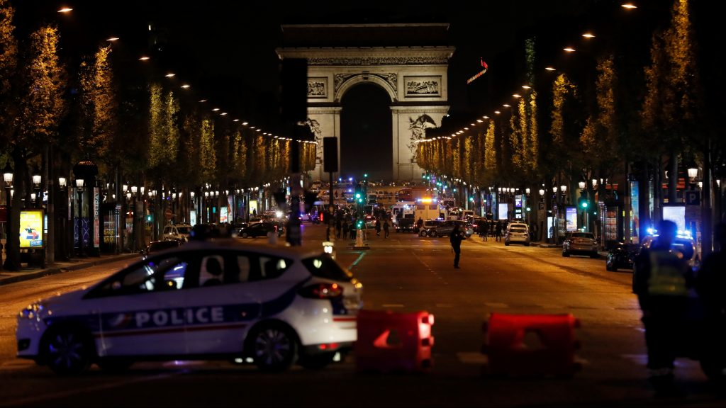 Police officers block the access to the Champs Elysees in Paris after a shooting on April 20, 2017. One police officer was killed and another wounded today in a shooting on Paris's Champs Elysees, police said just days ahead of France's presidential election. France's interior ministry said the attacker was killed in the incident on the world famous boulevard that is popular with tourists.  / AFP PHOTO / THOMAS SAMSON