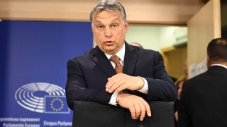 Hungary's Prime Minister Viktor Orban arrives to address a press conference after attending a plenary session at the European Parliament on the situation in Hungary, on April 26, 2017 in Brussels. The EU launched legal action against Hungary on April 26 setting up a major confrontation with Prime Minister Viktor Orban who accused Brussels of backing US billionaire investor George Soros instead of his country. Orban has sparked deep unease over legislation that could force the closure of the highly regarded Central European University in Budapest, founded by Soros.  / AFP PHOTO / EMMANUEL DUNAND