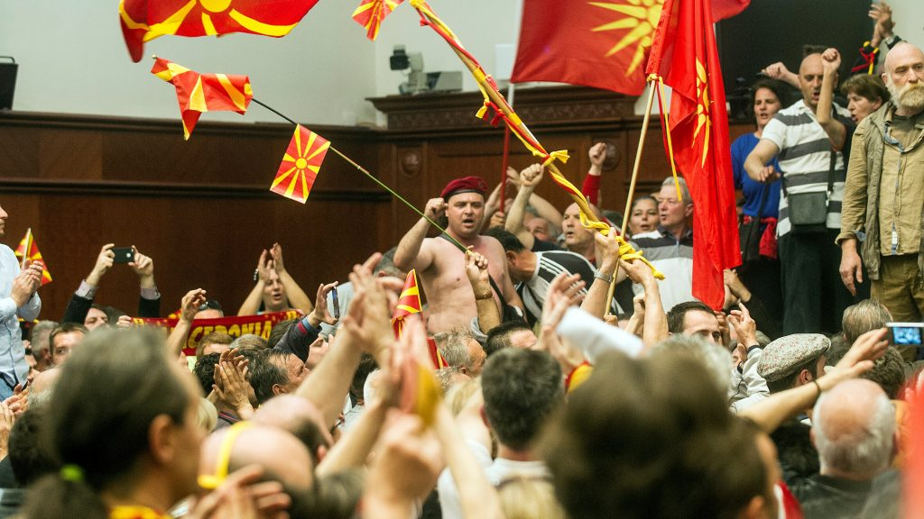 Protesters demonstrate inside Macedonia's parliament to protest against against what they said was an unfair vote to elect a parliamentary speaker, following months of political deadlock in the Balkan country in Skopje on April 27, 2017. / AFP PHOTO / Robert ATANASOVSKI