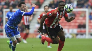 Bournemouth's English defender Adam Smith (L) chases Sunderland's Nigerian striker Victor Anichebe (R) during the English Premier League football match between Sunderland and Bournemouth at the Stadium of Light in Sunderland, north-east England on April 29, 2017.  / AFP PHOTO / Lindsey PARNABY / RESTRICTED TO EDITORIAL USE. No use with unauthorized audio, video, data, fixture lists, club/league logos or 'live' services. Online in-match use limited to 75 images, no video emulation. No use in betting, games or single club/league/player publications.  /