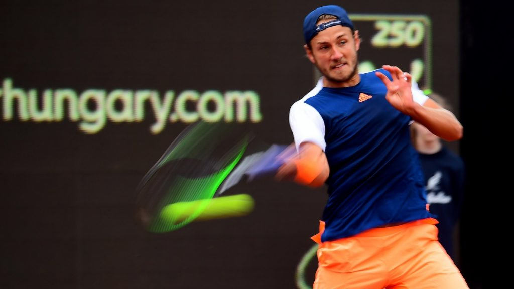 France' Lucas Pouille returns the ball to Italy's Paolo Lorenzi during the semi-final tennis match at the Hungarian Open in Budapest, on April 29, 2017.  / AFP PHOTO / ATTILA KISBENEDEK