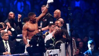 Britain's Anthony Joshua celebrates in the ring after his victory over Ukraine's Wladimir Klitschko in the eleventh round of their IBF, IBO and WBA, world Heavyweight title fight at Wembley Stadium in north west London on April 29, 2017. Britain's Anthony Joshua defeated veteran Ukrainian Wladimir Klitschko in a world heavyweight title fight epic in front of 90,000 people at Wembley on Saturday, taking victory on an 11th round stoppage. / AFP PHOTO / Ben STANSALL
