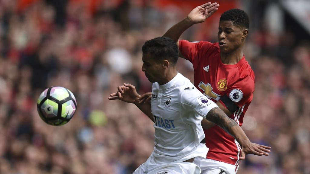Swansea City's English defender Kyle Naughton (L) holds off Manchester United's English striker Marcus Rashford (R) during the English Premier League football match between Manchester United and Swansea City at Old Trafford in Manchester, north west England, on April 30, 2017. / AFP PHOTO / Oli SCARFF / RESTRICTED TO EDITORIAL USE. No use with unauthorized audio, video, data, fixture lists, club/league logos or 'live' services. Online in-match use limited to 75 images, no video emulation. No use in betting, games or single club/league/player publications.  /