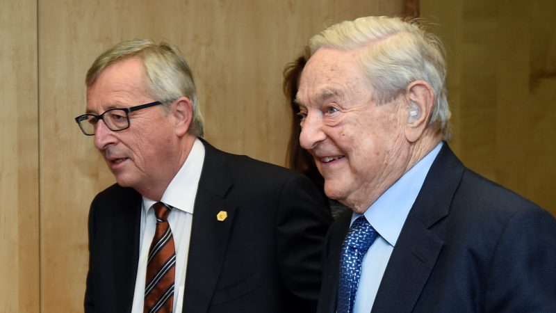 EU Commission president Jean-Claude Juncker (L) greets George Soros, founder and chairman of Open Society, ahead of their bilateral meeting at the EU headquarters in Brussels on March 20, 2015. AFP PHOTO / JOHN THYS / AFP PHOTO / JOHN THYS