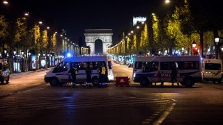 FRANCE, Paris: Police officers block the access to the Champs-Elysees near the Arc de Triomphe after a shooting in the area in Paris, France on April 20, 2017. One police officer was killed and another wounded today just days ahead of France's presidential election. France's interior ministry said the attacker was killed in the incident. - Nnoman CADORET