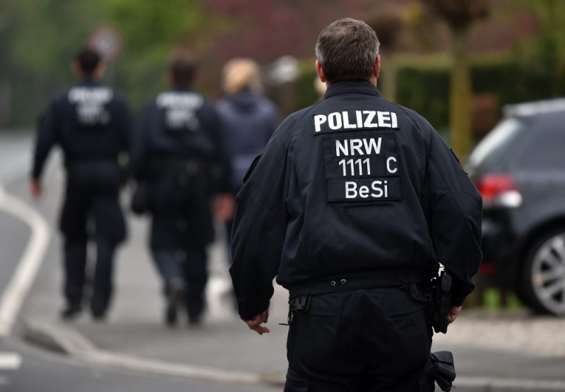 Policemen walking along the Wittbraeucker Strasse in Dortmund, Germany, 14 April 2017. After the attack on the team bus of Borussia Dortmund, the used-explosives and the ignition mechanism are the focus of the investigations. Photo: Caroline Seidel/dpa