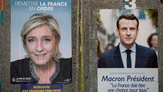 Election posters with the leading candidates for the presidential elections in France with  Le Pen (l) and E. Macron (c) can be seen in Henin-Beaumont, France, 23 April 2017. A total of eleven candidates participates in the first round of the presidential elections. Photo: Kay Nietfeld/dpa