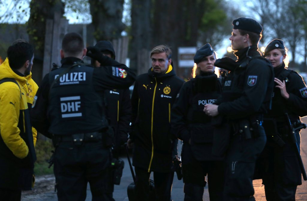 DORTMUND, GERMANY - APRIL 11 : Nuri Sahin and Marcel Schmelzer (C) of Borussia Dortmund stand at their bus at the hotel L'Arrivee in Germany on April 11, 2017.  The UEFA Champions League quarter-final soccer match between Borussia Dortmund and AS Monaco has been postponed after an explosions near the bus carrying the Dortmund team, injuring one player. INA FASSBENDER / Anadolu Agency