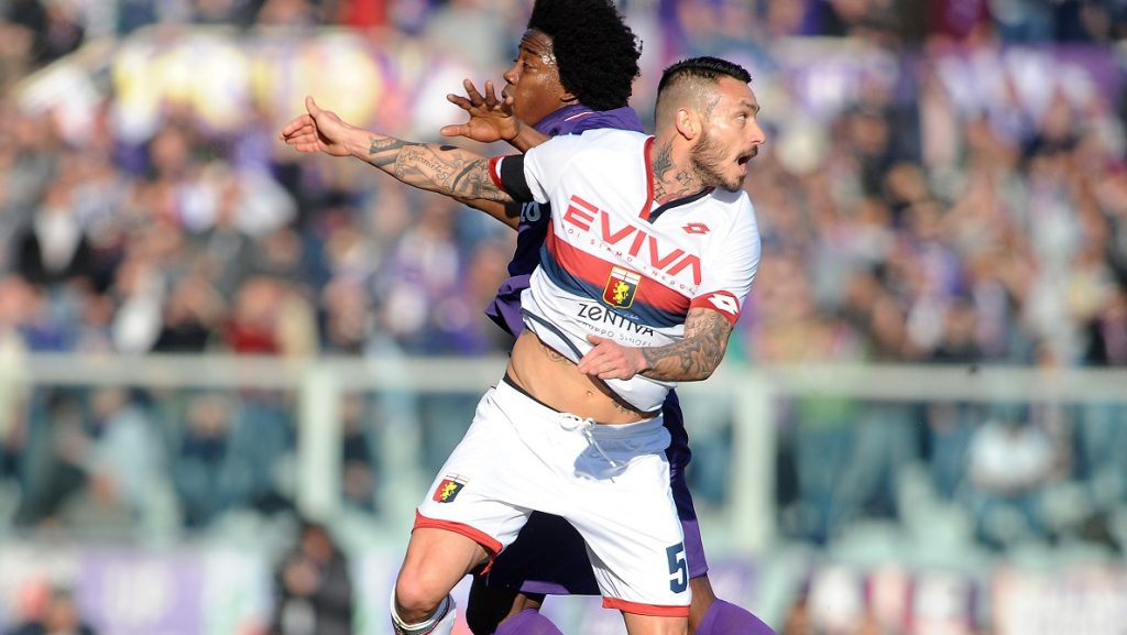 FLORENCE, ITALY - JANUARY 29: Carlos Sanchez (6) of Acf Fiorentina in action with Mauricio Pinilla (51) of Genoa Fc during Italian Serie A soccer match between ACF Fiorentina and Genoa FC at Stadio Artemio Franchi in Florence, Italy on January 29, 2017. Carlo Bressan / Anadolu Agency