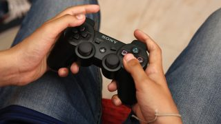 TEENAGER PLAYING VIDEO GAME  Video game parlour in La Marsa, Tunisia.   GODONG / BSIP