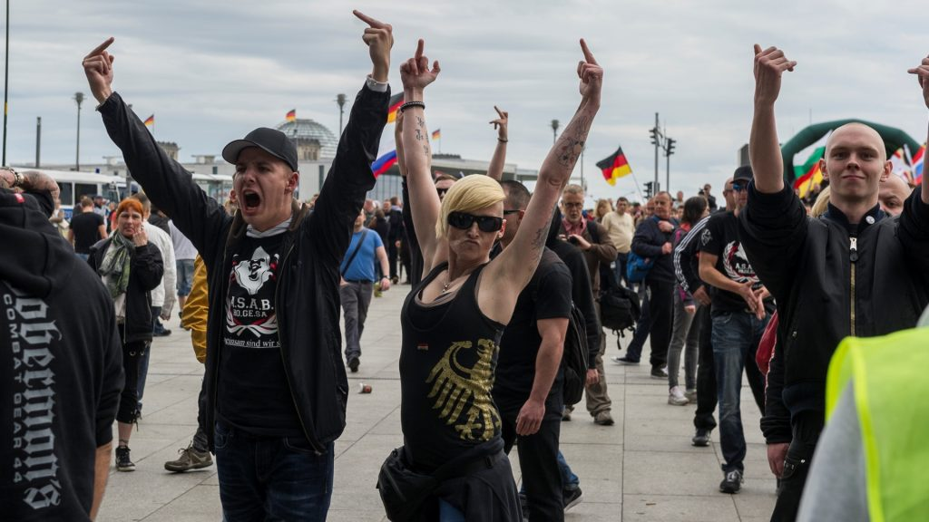 """Participants at the rally call """" storm on the Reichstag """" on 09.05.2015 before the main train station in Berlin , Germany slogans towards the counter-demonstrators . About 300 demonstrators who are assigned to the right-wing plan when removing a """" storming of the Reichstag """" and oppose Islamization and Americanization of Europe. (Photo by Markus Heine/NurPhoto)"""