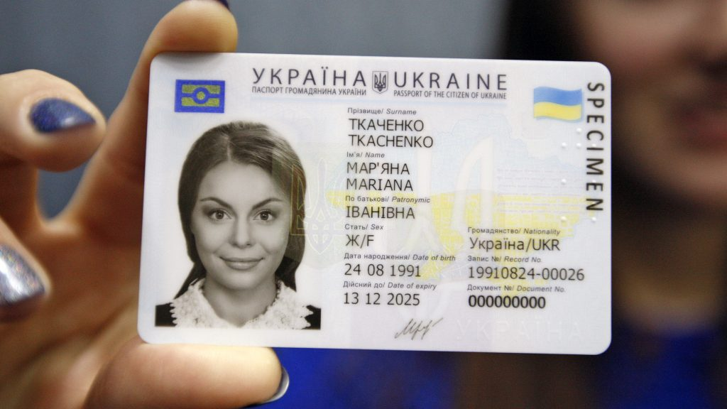 An Ukrainian girl holds in her hand a specimen of a new ID passport of citizen of Ukraine in Kiev,Ukraine,05 January, 2016. From January 11 the State Migration Service starts registration of the new ID passports for citizens of Ukraine,Sokolyuk said. Ukrainian President Petro Poroshenko confirmed the positive evaluation of Ukraine's preparation for the European Commission plans to liberalize the visa regime.The Foreign Ministry of Ukraine expects the liberalization of the visa regime with EU in 2016, according to local media. (Photo by STR/NurPhoto)