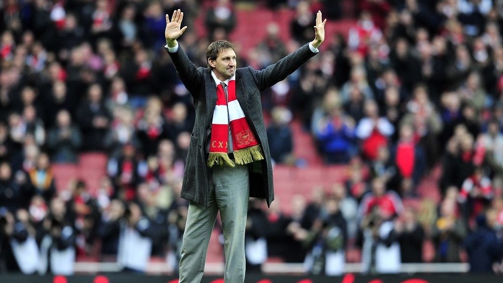 """Ex-Arsenal legend Tony Adams waves to the crowd before the English Premier League football match between Arsenal and Queens Park Rangers at The Emirates Stadium in north London, England on December 31, 2011. AFP PHOTO/GLYN KIRK  RESTRICTED TO EDITORIAL USE. No use with unauthorized audio, video, data, fixture lists, club/league logos or """"live"""" services. Online in-match use limited to 45 images, no video emulation. No use in betting, games or single club/league/player publications. / AFP PHOTO / GLYN KIRK"""