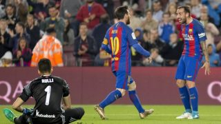 BARCELONA, SPAIN - APRIL 15: Lionel Messi (C) of Barcelona celebrates with his teammate Paco Alcacer (R) after scoring a goal during the Spanish League match between the FC Barcelona and Real Sociedad at the Camp Nou Stadium in Barcelona, Spain on April 15, 2017.