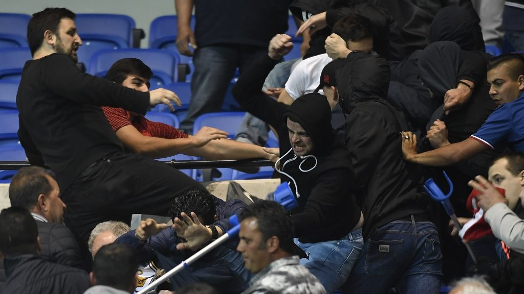 Besiktas' and Lyon's supporters fight in the tribune before  the UEFA Europa League first leg quarter final football match between Lyon (OL) and Besiktas on April 13, 2017, at the Parc Olympique Lyonnais stadium in Decines-Charpieu, central-eastern France. / AFP PHOTO / PHILIPPE DESMAZES