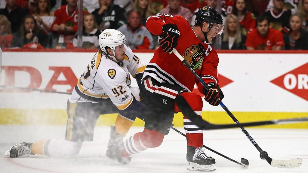 CHICAGO, IL - APRIL 15: Jonathan Toews #19 of the Chicago Blackhawks gets off a shot under pressure from Ryan Johansen #92 of the Nashville Predators in Game Two of the Western Conference First Round during the 2017 NHL Stanley Cup Playoffs at the United Center on April 15, 2017 in Chicago, Illinois. The Predators defeated the Blackhawks 5-0.   Jonathan Daniel/Getty Images/AFP