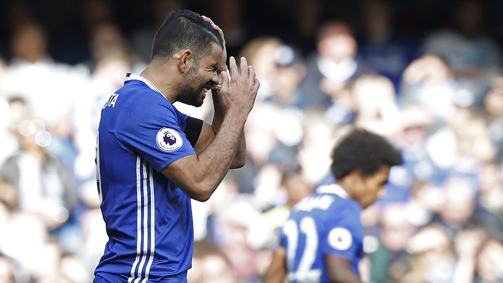 Chelsea's Brazilian-born Spanish striker Diego Costa reacts to missing a chance during the English Premier League football match between Chelsea and Crystal Palace at Stamford Bridge in London on April 1, 2017. / AFP PHOTO / Ian KINGTON / RESTRICTED TO EDITORIAL USE. No use with unauthorized audio, video, data, fixture lists, club/league logos or 'live' services. Online in-match use limited to 75 images, no video emulation. No use in betting, games or single club/league/player publications.  /