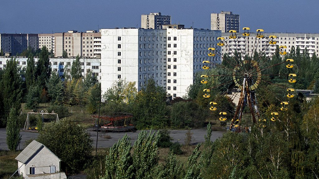 PRYPYAT, UKRAINE - JUNE, 2006: Views of Prypyat, a joyful town established in 1970 which population of more than 45,000 habitants, seen here on June 1, 2006 inside the Chernobyl exclusion, Ukraine. It is located only about 1.5km from the Chernobyle nuclear power plant, and was entirely evacuated on April 27, 1986, the day after the Chernobyl explosion. Today, it is a ghost town and entry is still forbidden. The town of Prypyat was created in order to house the Chernobyl nuclear power plant workers and their families. The inhabitants were privileged, as their salary was higher thank the norm in the USSR. (Photo by Patrick Landmann/Getty Images)