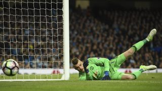 Manchester United's Spanish goalkeeper David de Gea (R) saves a shot during the English Premier League football match between Manchester City and Manchester United at the Etihad Stadium in Manchester, north west England, on April 27, 2017. / AFP PHOTO / Oli SCARFF / RESTRICTED TO EDITORIAL USE. No use with unauthorized audio, video, data, fixture lists, club/league logos or 'live' services. Online in-match use limited to 75 images, no video emulation. No use in betting, games or single club/league/player publications.  /