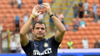 Former Inter Milan's player Dejan Stankovic waves to supporters during the Serie A football match Inter Milan vs Genoa at San Siro Stadium in Milan on August 25, 2013. AFP PHOTO / GIUSEPPE CACACE / AFP PHOTO / GIUSEPPE CACACE