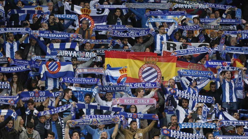 RCD Espanyol supporters wave scarves before the Spanish league football match RCD Espanyol vs FC Barcelona atthe Cornella-El Prat stadium in Cornella de Llobregat on April 29, 2017. Barcelona won 3-0. / AFP PHOTO / PAU BARRENA