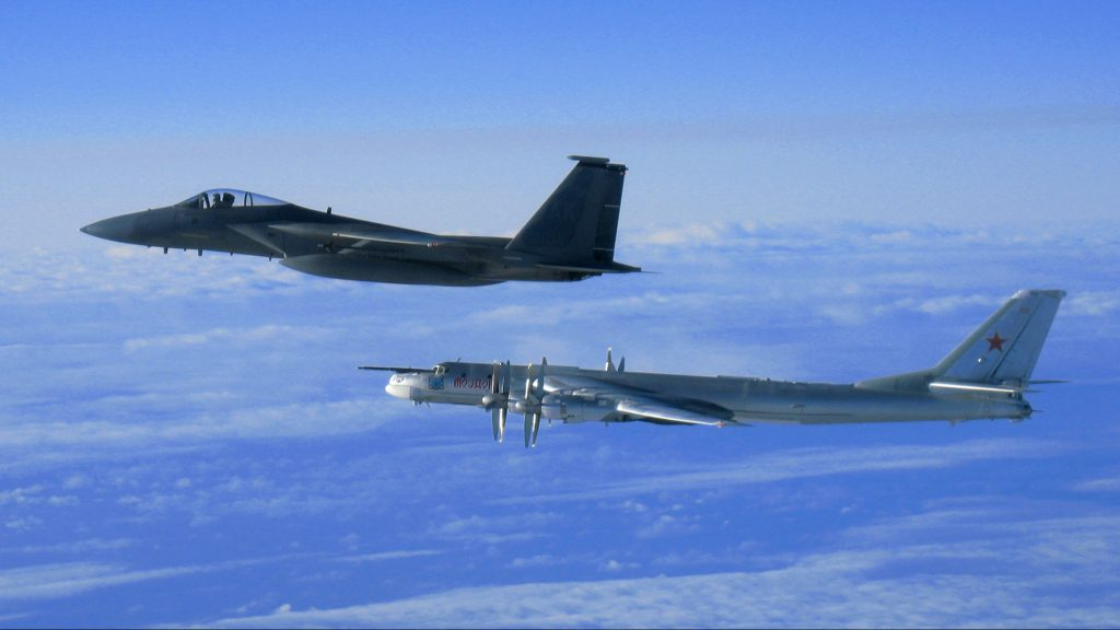 An F-15 Eagle from the 12th Fighter Squadron at Elmendorf Air Force Base flies next to a Russian Tu-95 Bear Bomber Sept. 28 during a Russian exercise that brought the Bear near the west coast of Alaska.  The Eagle took off as part of North American Aerospace Defense Command's reaction to this training opportunity provided by the Russian 137th Air Army. (U.S. Air Force photo)