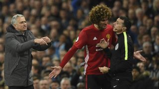 Manchester United's Portuguese manager Jose Mourinho (L) indicates he wants to make a substitution as Manchester United's Belgian midfielder Marouane Fellaini (C) talks to fourth official Neil Swarbrick (R) after Fellaini was sent off during the English Premier League football match between Manchester City and Manchester United at the Etihad Stadium in Manchester, north west England, on April 27, 2017. / AFP PHOTO / Oli SCARFF / RESTRICTED TO EDITORIAL USE. No use with unauthorized audio, video, data, fixture lists, club/league logos or 'live' services. Online in-match use limited to 75 images, no video emulation. No use in betting, games or single club/league/player publications.  /